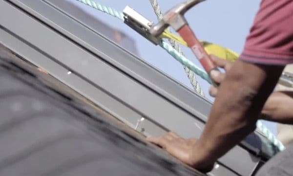 Nailing the flashing down on a new skylight