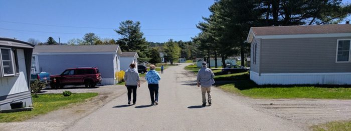 Neighbors walking in resident-owned manufactured home community