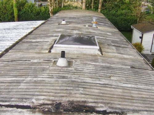 Old Metal Roof Before Mobile Home Roof Over 500x373 1