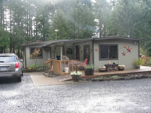 Oregon-mobile home with addition for sale - cool painted exterior