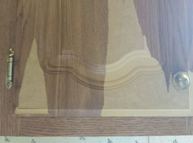 Paper-peeling-from-mdf-cabinet-in-mobile-home-hometalk