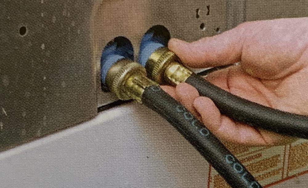 disconnecting hoses from washing machine