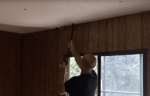 Pulling old ceiling down in a mobile home10