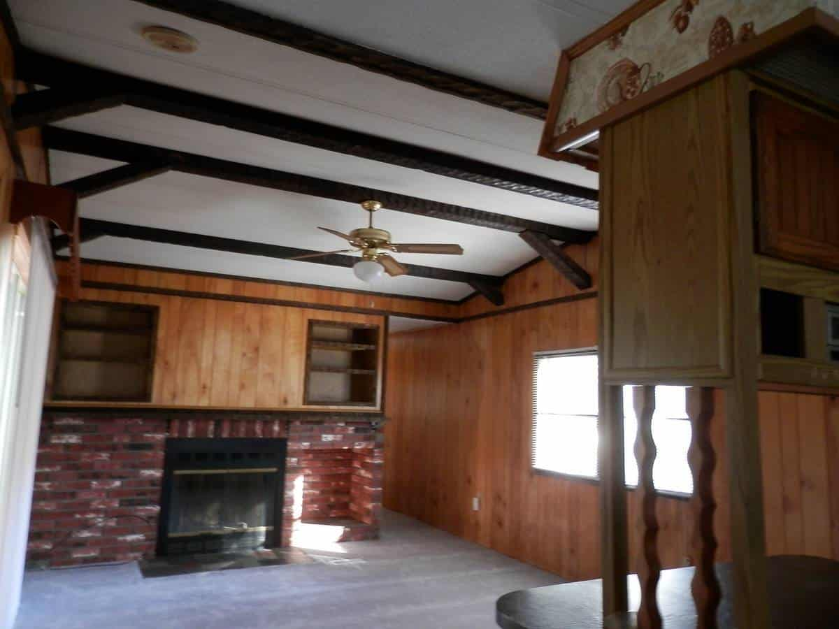 Rustic wood beams on a mobile home ceiling
