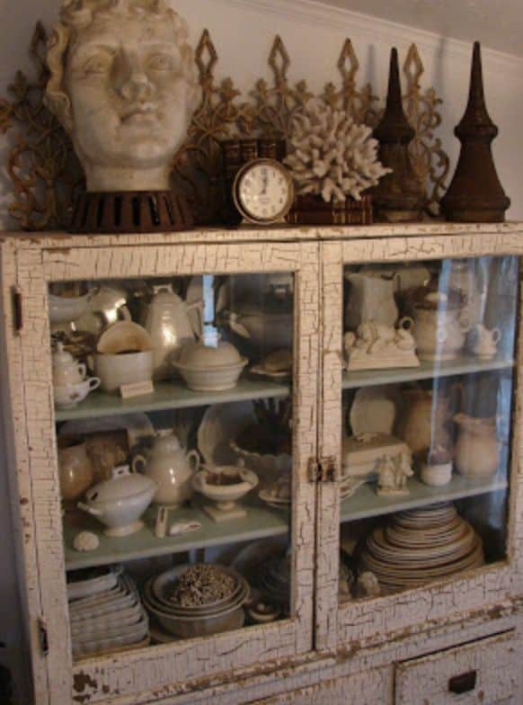 glass door cabinet with ironware collection