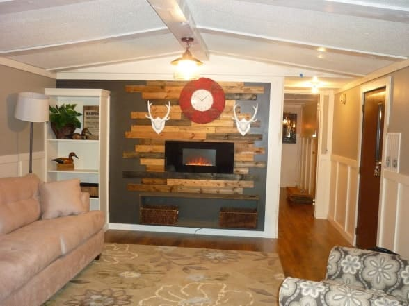 Single wide mobile home living room with wood accent wall 1