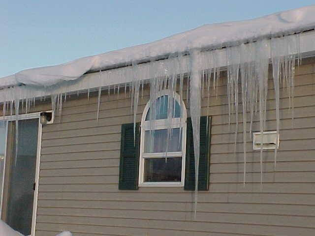 winterize your mobile home with these expert tips - snow and ice on a manufactured home - landhomebuyer comcompressedoptimized
