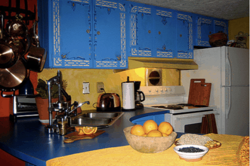 South western blue cabinets in mobile home kitchen