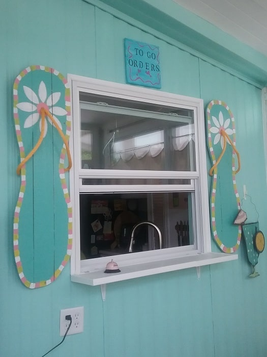 flip flop shutters on a mobile home beach house