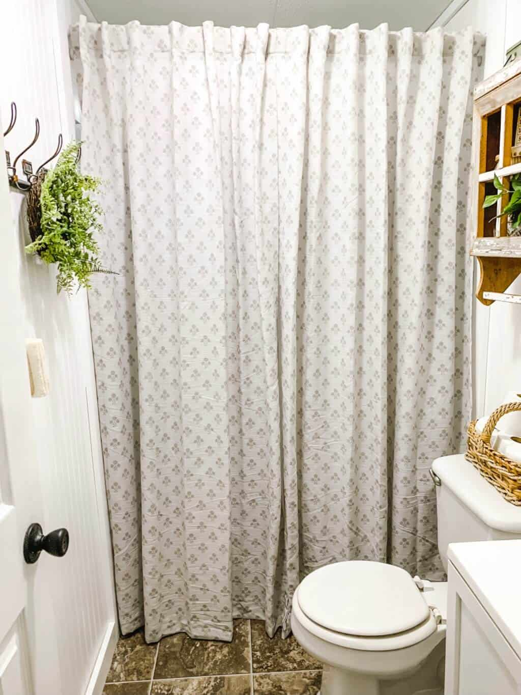 Tall shower curtain adds height for low ceilings - affordable farmhouse bathroom makeover