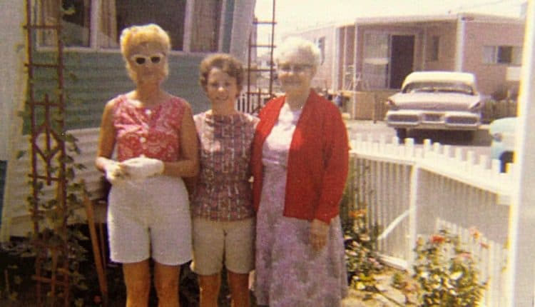 Three women in a mobile home park