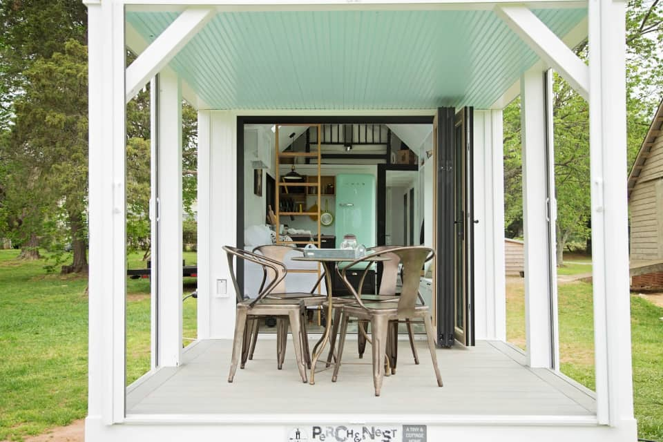 Tiny house porch with retractable screens