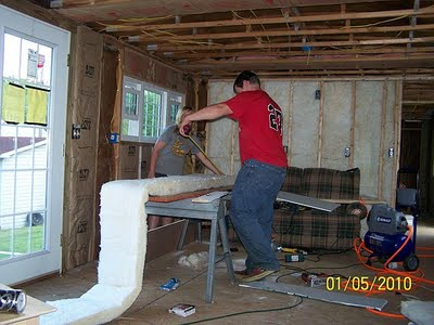 total mobile home transformation - putting new insulation in walls