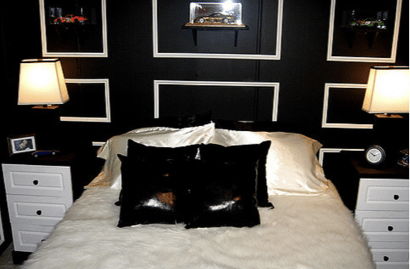 Black walls with white trim in bedroom