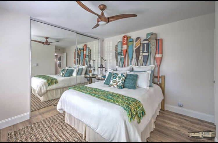 Use oars as a headboard to update your mobile home bedroom