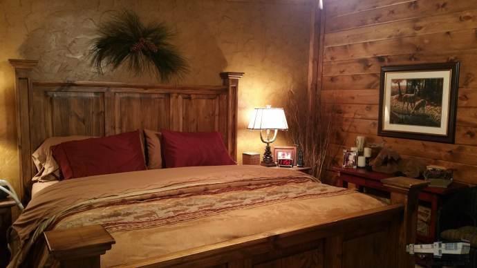 Warm wood wall in master bedroom