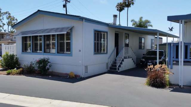 1988 Skyline Double Wide - Complete remodel - Manufactured Home Interior Design - Exterior Before - front 3