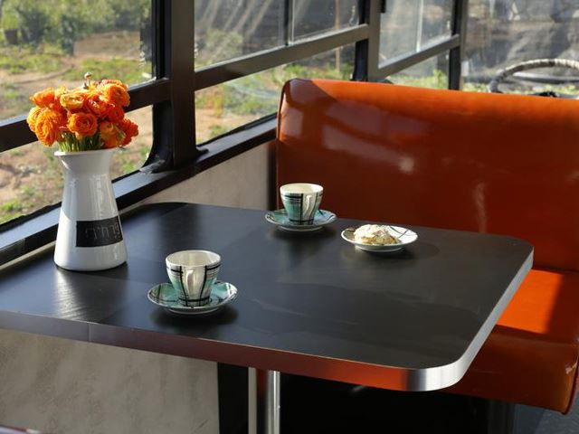 vintage buses-Abandoned Bus Remodeled into beautiful mobile home Dining Area