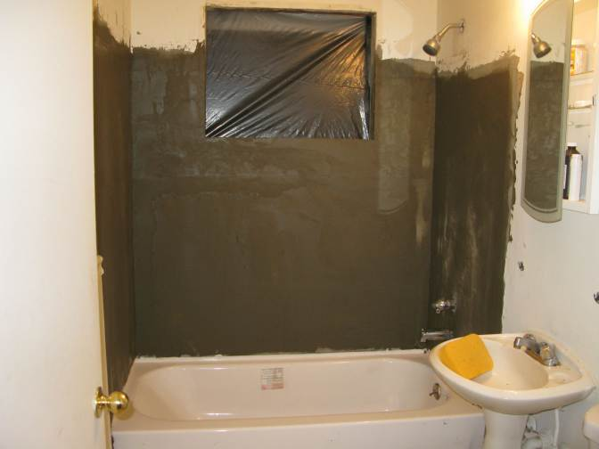 Bathroom 1 - Mortar base coat added over cement board