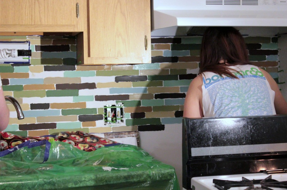 painting the tiles for affordable diy backsplash project