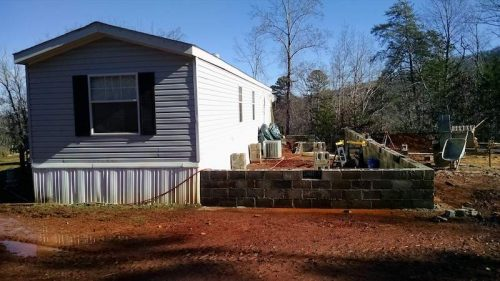 Building a Two-Story Addition onto a Manufactured Home - the single wide with the foundation of the addition