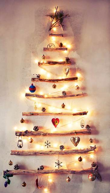 Christmas Tree made from tree branched hung on wall - Affordable DIY Christmas Decor