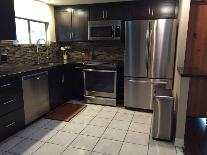 by saving money on the cabinetry sylvia was able to complete the kitchen remodel with a glass tile backsplash the glass tile was a splurge at 15 per
