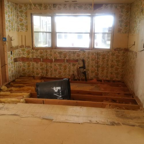 gutted kitchen during $45,000 manufactured home renovation
