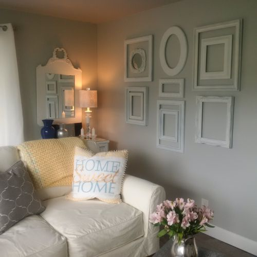 gallery wall in living room after $45,000 manufactured home renovation