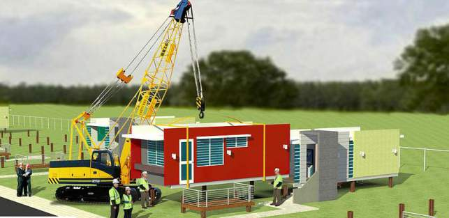 Crane placing a new evergreen eco home on buyer's property