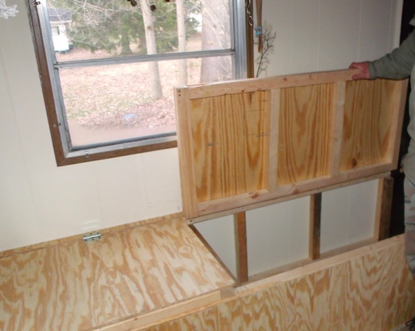 Creating Storage in a Mobile Home with a Window Seat - lifting the seat up to access storage space