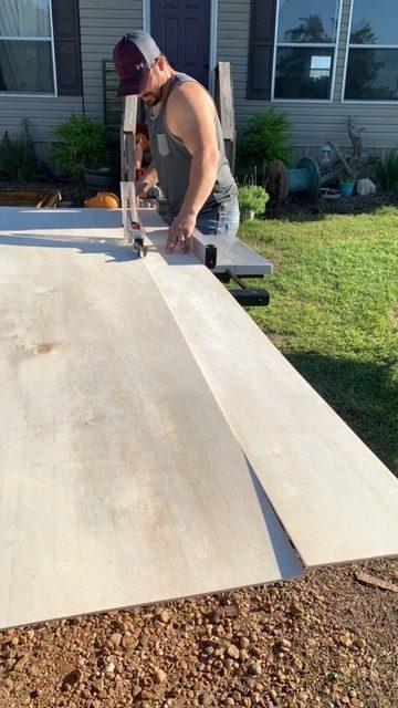 DIY farmhouse flooring cutting plywood into planks on table saw 2