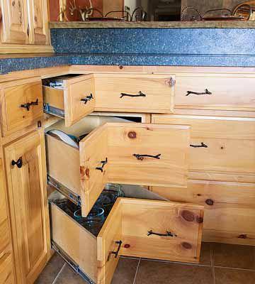 Down-home-on-the-range-corner drawer in cabin kitchen_c