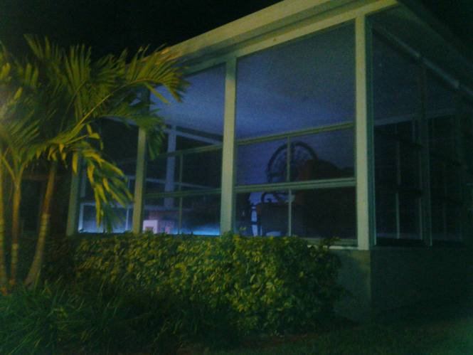 Florida double wide-FL Remodeled Manufactured Home Shines Bright (night time screened porch)