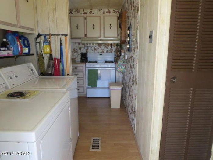 The view from the laundry area coming from the master suite hallway. The dining area is on the other side of the wall.
