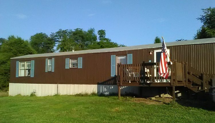 How to Paint Metal Siding on a Mobile Home - Home with Shutters