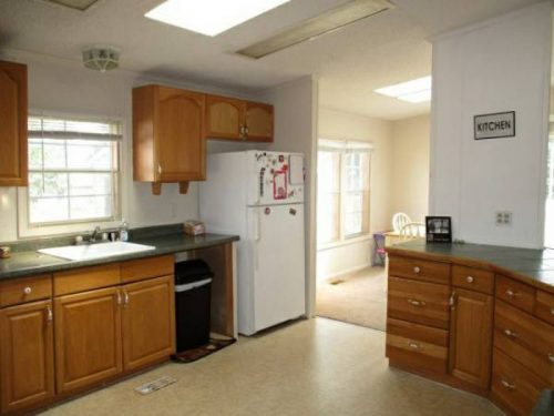 our favorite manufactured home ads from August 2017 - MI double wide for $14k - kitchen