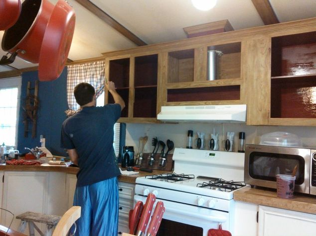 farmhouse kitchen makeover-painting-upper-cabinet-interiors