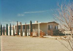 Exterior Mobile Home Remodel: Desert Double Wide - Old Home Before Remodel