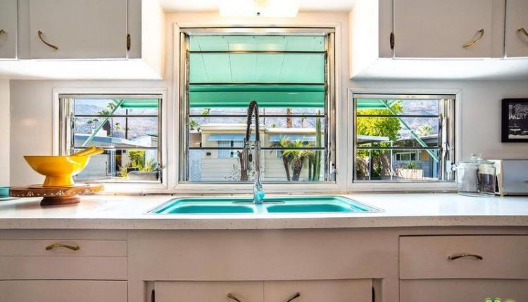 1962 Skyline is a Vintage Mobile Home Beauty -Teal Kitchen Sink