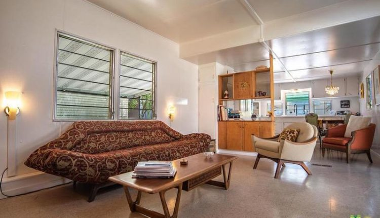 1962 Skyline single wide is a Vintage Mobile Home Beauty - natural wood builtin in living room