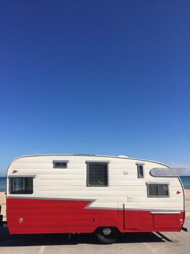 affordable DIY vintage camper renovation - Exterior of the Shasta Camper after renovation