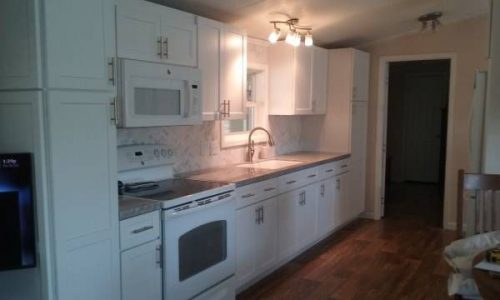 Mobile Homes for Sale - 2001 Clayton Single Wide has a clean white kitchen