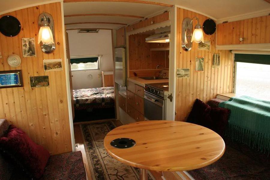vintage buses-The Emerald Gypsy - Vintage Bus Conversions Interio Dining Area