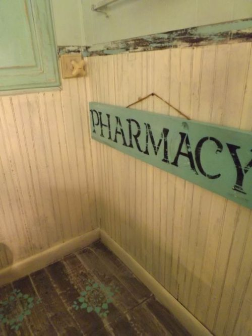 Vintage Farmhouse Decor in a Mobile Home - guest bathroom remodel - stenciled floor project