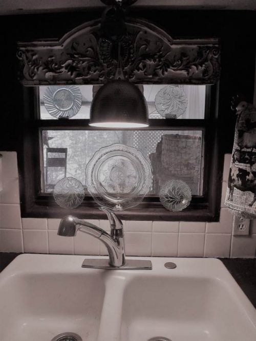 Vintage farmhouse decor in a mobile home - kitchen remodel - sink and window
