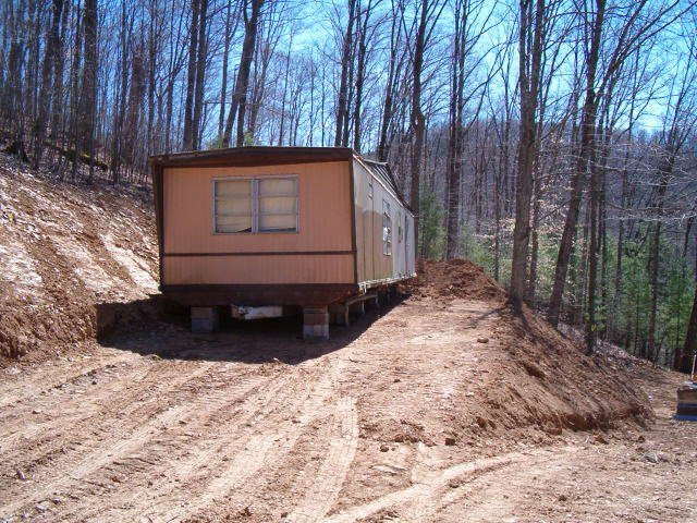 environmentally friendly houses - green mobile home remodel before