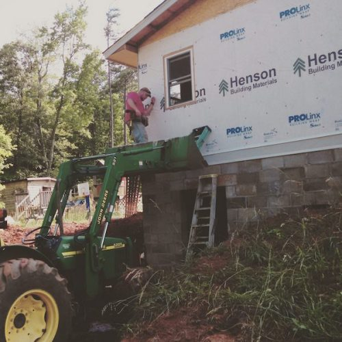 adding an addition to your house - installing siding onto the manufactured home addition