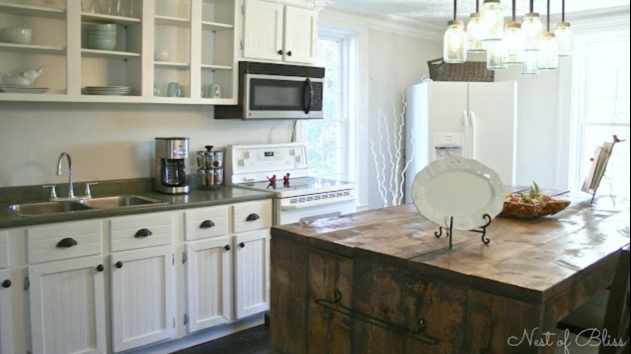 affordable ideas to update mobile home kitchen - add bead board paper to cabinets 3