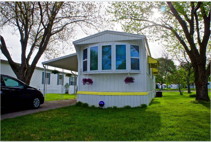 affordable mobile home remodel - 1968 Landola single wide goes Retro (exterior trim painted)